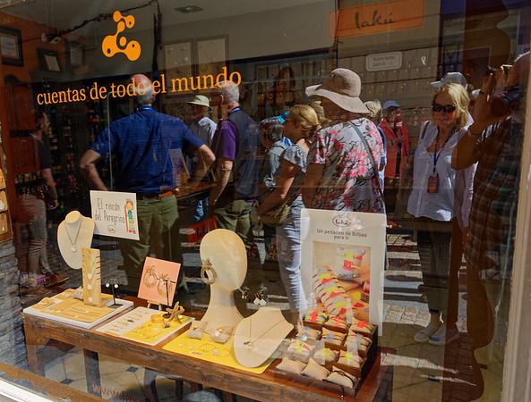 Bilbao, Basque Country, Spain - Carla window shops