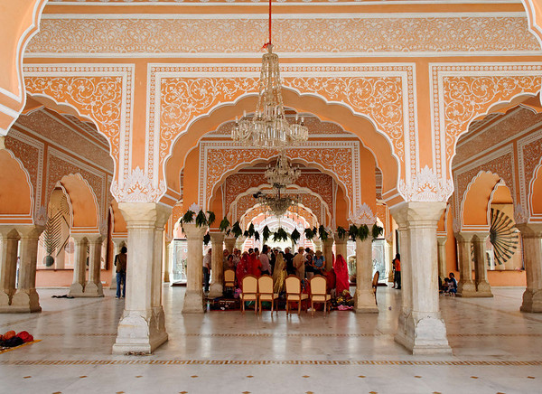 City Palace, Jaipur.  Diwan-I-Khas was a private audience hall of the Maharajas, a marble floored chamber. It is located between the armoury and the art gallery. There are two huge sterling silver vessels of 5.2 ft height and each with capacity of 4000 litres and weighing 750 lb, on display here. They were made from 14000 melted silver coins without soldering. They are officially recorded by the Guinness Book of World Records as the world's largest sterling silver vessels. These vessels were specially made by Maharaja Sawai Madho Singh II, who was a highly pious Hindu, to carry the Ganga river water to drink on his trip to England in 1901 (for Edward VII's coronation) as he was finicky about committing religious sin by consuming the English water. Hence, the vessels are named as Gangajelies (Ganga water holding urns). There are a number of crystal chandeliers hanging from the ceiling (normally covered with plastic sheets to prevent dust collection), which are uncovered on special occasions.