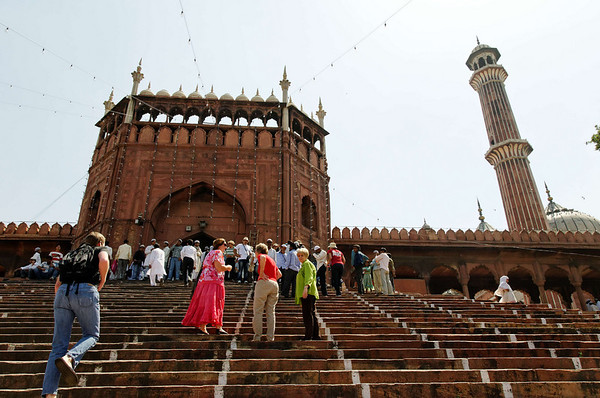 Climbing the steps to Jama Masjid Mosque, built 1656, Delhi