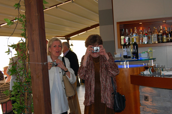 These ladies are capturing David Jones & group striking a local protective pose farewell reception Sestri Levante, Italy