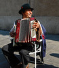 A very happy accordionista who just marched in the May Day Parade Genova, Italy