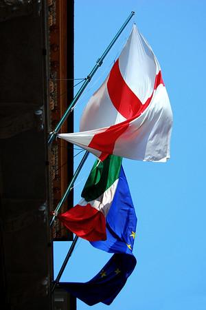 Flags on Via Garibaldi Genova, Italy