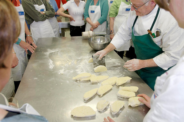 Chef cuts the gnocchi dough into slabs prior to rolling.
