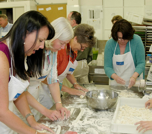 Cindy, Nancy, Suzanne, and Trish roll out the gnocchi.