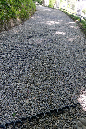 metal grid for holding large gravel in place - makes for a water-permeable walk