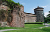 Castello Sforzesco, unrestored to left, restored to the right.
