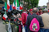 Bersaglieri hats for sale, man with Italian suit,  pink backpack