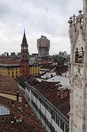 Roof of the Duomo to ancient clock tower without hands (bells).