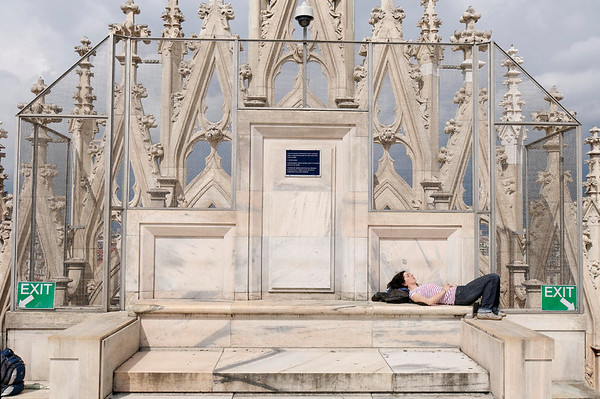 Cool day, sunning herself on Duomo rooftop, Milan