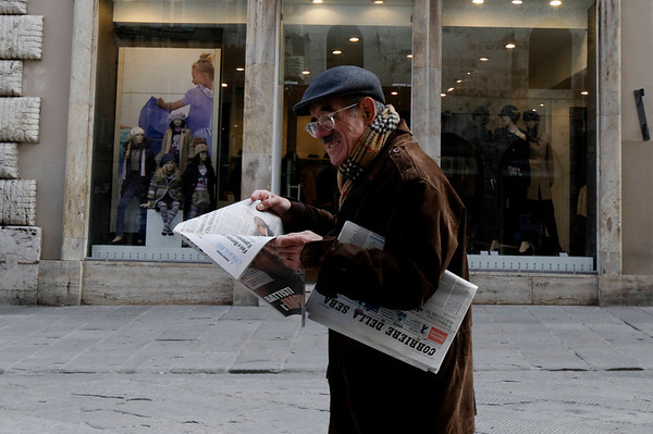 Perugia, Italy, local reading the paper - from the looks of it he may not like what he's reading.
