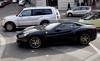 Rome, Italy; and a black Ferrari