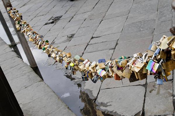 Florence, Italy; bike locks along the Arno