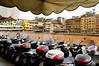 Florence, Italy; motorbikes along the Arno