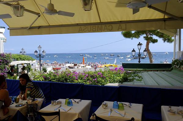 Beach and harbor scene, Positano Italy