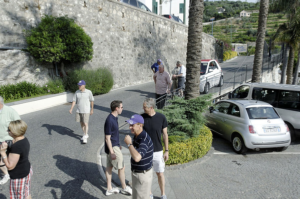 DAY 6:  Getting ready to move the white Smart Car in the way of our bus, let's see, 1600 lbs is 400 per corner with 2/corner, that's only 200 lbs per person - come on guys!  Hotel Raito, Vietri sul Mare Italy