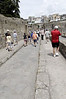 Unlike Pompeii which was a town with many business interests, Herculaneum was a resort village with a functional sewer system, thus the shallow streets with no stepping stones.