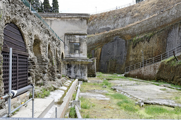 The Antica Spiaggia (Ancient Shoreline), with the boat storage bays, showing the depth of coverage, the shoreline being moved a distance away, Herculaneum