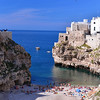 Polignano a Mare, hotel on left, beach, and old town