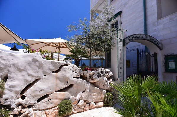 Polignano a Mare, Covo dei Saraceni, natural rock wall and entrance to hotel restaurant