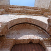 Andria, Castle del Monte, entrance showing the one remaining lion and slot for the gate