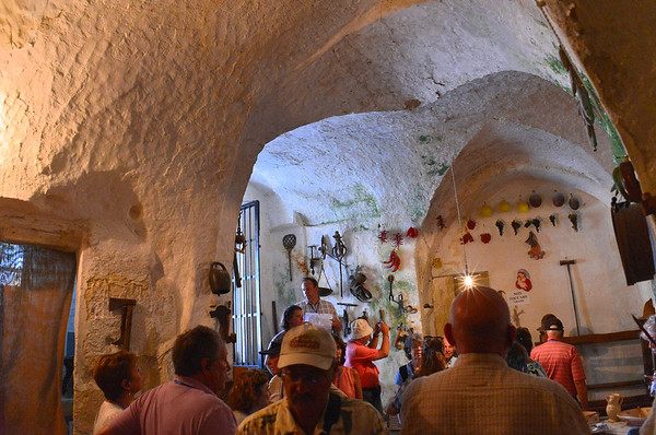 Matera, interior of a sassi.  Carved out of soft stone and occupied from the 1400s to the 1950s, the sassi provided basic shelter but poor living conditions for the people of the area.  The site bacame a UNESCO World Heritage site in 1993.