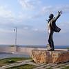 Statue of Domenico Modugnio, composer/singer of Volare in 1956,  by hotel Covo dei Saraceni, Polignano a Mare
