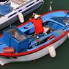 Trani, working on small boat in marina