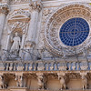 Lecce, detail of rose window of baroque cathedral Basilica of Santa Croce
