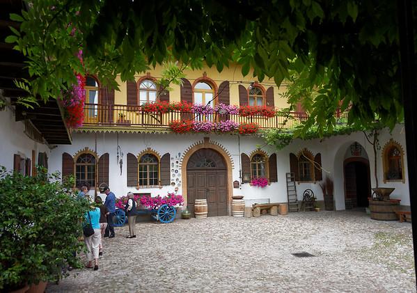 Marano, Azienda Agricola de Tarczal; wisteria and geraniums surrounded courtyard