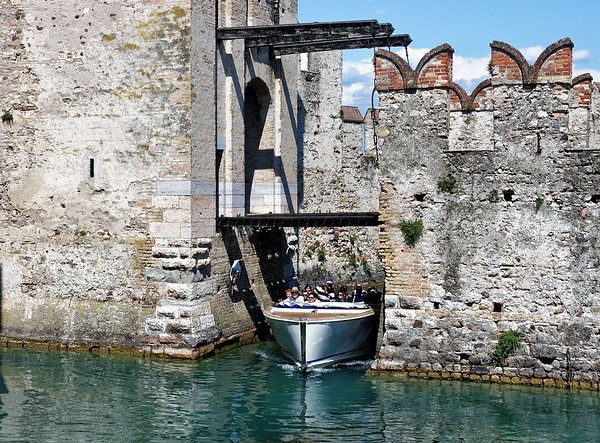Sirmione; boat coming through moat