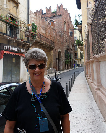 Verona: Suzanne with Romeo's house in the background