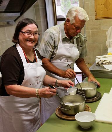 Borgo San Donino; Carol and Brant get the pannacotta ready