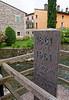 Valeggio and the Mincio river; marker celebrating the 100th anniversary