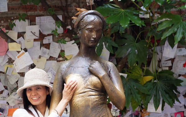 Verona: traditional pose with statue of Juliet (It's Verona after all!)