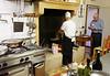 Marano di Valpolicella; making polenta, the chef adds the corn meal
