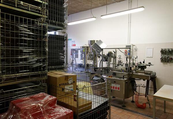 Marano di Valpolicella; bottles of wine and labeling equipment