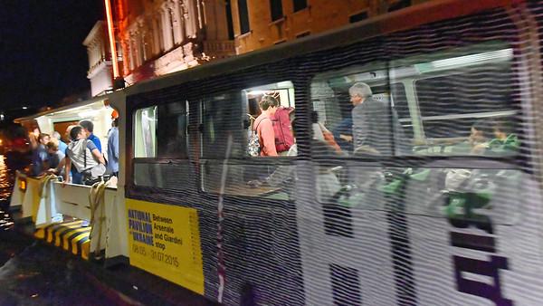 Venice; night cruise by water bus, water bus scene