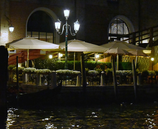 Venice; night cruise by water bus, cafe scene