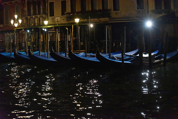 Venice; night cruise by water bus, gondolas parked for the night