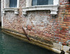 Venice; brace trying to hold sides together and extensive brick damage from wicking salt water