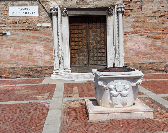 Venice; original plaza style brick in herringbone pattern, water cistern in center, small hole to the left is water for the cats to keep the mice at bay