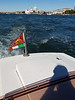 Venice; our water taxi flying both the Italian and Venetian flags (Venetian first, then Italian)