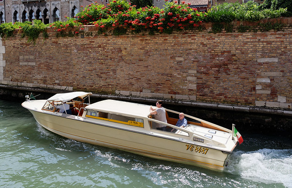 Venice; tourist boat and canal scene