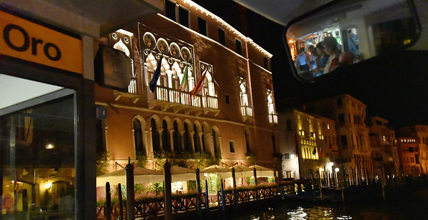 Venice; night cruise by water bus, Suzanne in the mirror