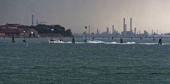 Venice; Murano Island, squal hits, pylons mark safe channels in a shallow bay