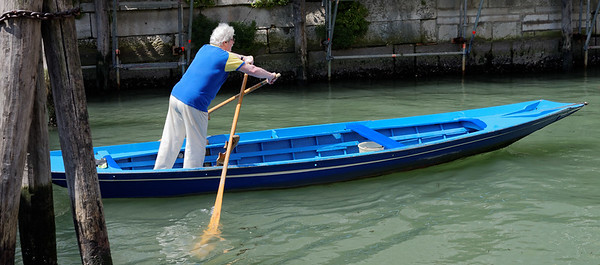 Venice; rowing clubs are the item in this area, done standing up