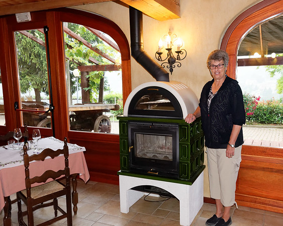 DAY 10:  After Expo Milano 2015 yesterday, we just hung out and played cards. Today we leave Mondo and go to meet our UT group in Verona. Here is Suzanne at breakfast with the small pizza oven