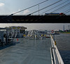 Under the Stan Span with the navigation bridge and stacks lowered