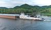 Tug Boat pushing a barge load