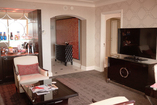 Four Seasons room entrance, bar and door to bedroom